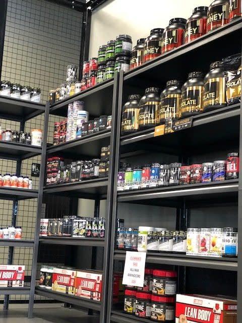 supplements on a shelf - Train Hard Fitness 8180 Oswego Rd. Liverpool, NY 13090 315-409-4764