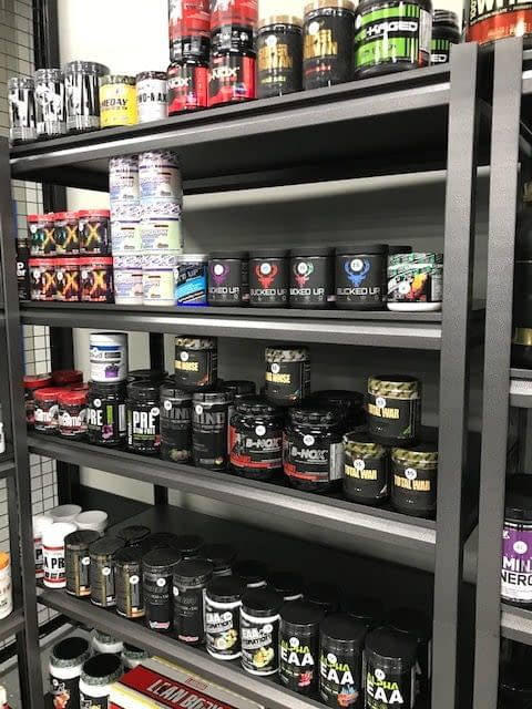 supplements on a shelf - Train Hard Fitness 8180 Oswego Rd. Liverpool, NY 13090 315-409-4764