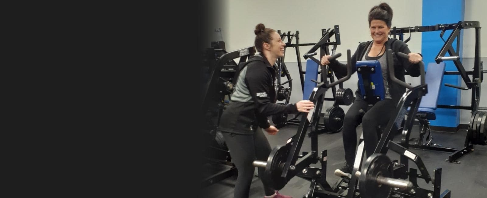 Personal trainer coaching a woman on an excercise bike - Train Hard Fitness  8180 Oswego Rd.  Liverpool, NY 13090  315-409-4764
